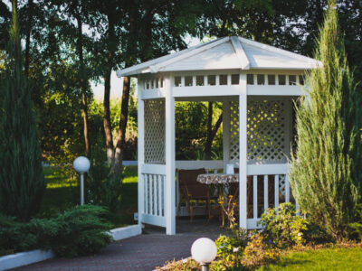 white-wooden-arbor-street-green-park-cozy-place-spend-time_105751-8425
